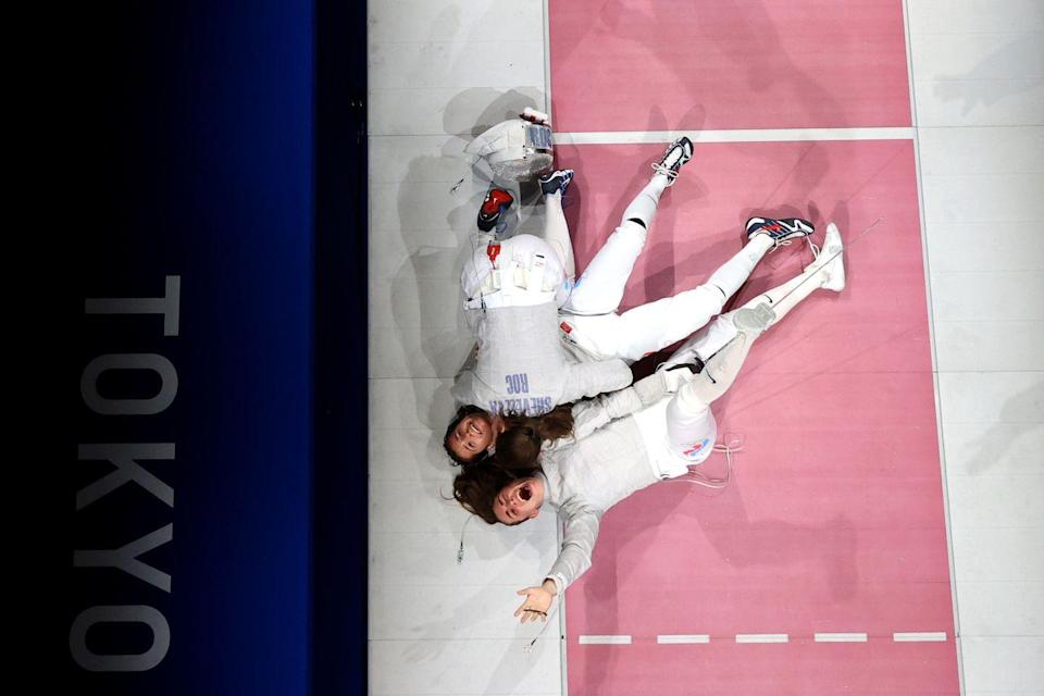<p>Team ROC celebrates after winning the women's sabre team fencing gold medal match against France. </p>