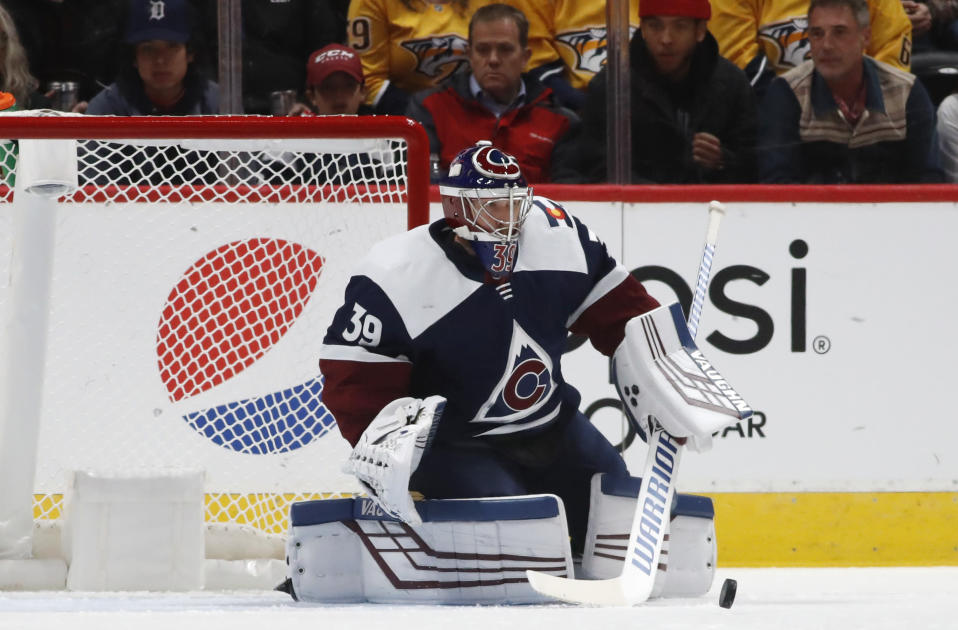 Colorado Avalanche goaltender Pavel Francouz makes a stick save against the Nashville Predators during the first period of an NHL hockey game Thursday, Nov. 7, 2019, in Denver. (AP Photo/David Zalubowski)