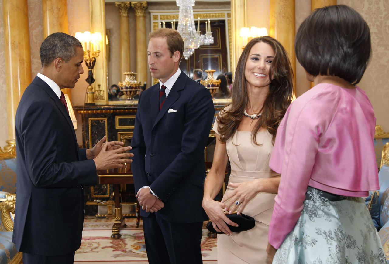 U.S. President Barack Obama (L) and first lady Michelle Obama (R) talk to Britain's Prince William (2nd L) and Catherine, Duchess of Cambridge at Buckingham Palace, in London May 24, 2011.