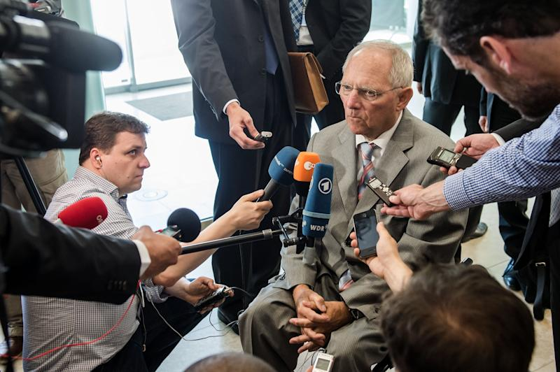 Germany's Finance Minister Wolfgang Schauble talks with journalists as he arrives for a Eurogroup meeting in Luxembourg, Thursday, June 20, 2013. (AP Photo/Geert Vanden Wijngaert)
