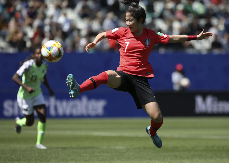 South Korea's Lee Min-a stretches for the ball during the Women's World Cup Group A soccer match between Nigeria and South Korea in Grenoble, France, Wednesday June 12, 2019.(AP Photo/Laurent Cipriani)
