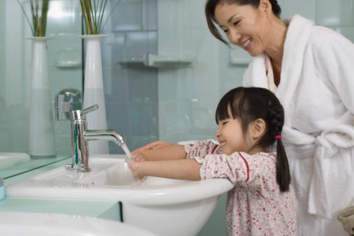 """<p><b>1. Keep their hands clean.</b></p> <p><em>Health Canada</em> <a href=""""http://www.hc-sc.gc.ca/hl-vs/iyh-vsv/diseases-maladies/hands-mains-eng.php"""" target=""""_blank"""">recommends</a>  washing hands frequently with soap and water, lathering soap in your  hands for the 15-second duration of """"Happy Birthday."""" Hand-washing is  considered the most effective strategy in protecting both yourself and  others from a number of infectious diseases, including influenza.</p> <p><a href=""""http://www.caringforkids.cps.ca/handouts/handwashing"""" target=""""_blank"""">When washing a baby's hands</a>, use soap and a warm, wet cloth. Rinse the baby's hands with another clean warm, wet towel.</p> <p>Warning: Don't use a single damp cloth to wash a group of children's hands.</p><p>(Credit: Thinkstock) </p>"""