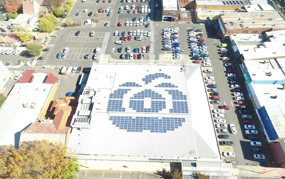 Solar panels make up a Woolworths logo on a store roof. Source: Woolworths Group