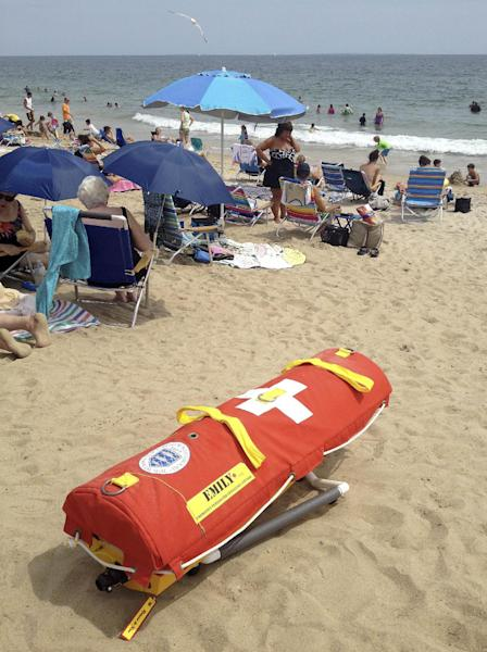 In this Wednesday, Aug, 8, 2012 photo, EMILY, (Emergency Integrated Lifesaving Lanyard) a remote-controlled battery powered lifesaving device, sits on Old Town Beach in Westerly, R.I. EMILY is a small watercraft fitted with a flotation device and can go up to 22 mph, allowing it to get to people more quickly, and in some cases more safely, than any human. (AP Photo/Michelle R. Smith)