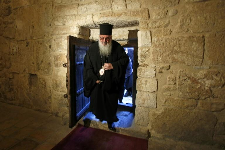 Bishop Theophylactos reopens Bethlehem's Church of the Nativity, built on the spot where Christians believe Jesus was born, as Palestinian authorities ease coronavirus restrictions in the occupied West Bank (AFP Photo/Musa Al SHAER)