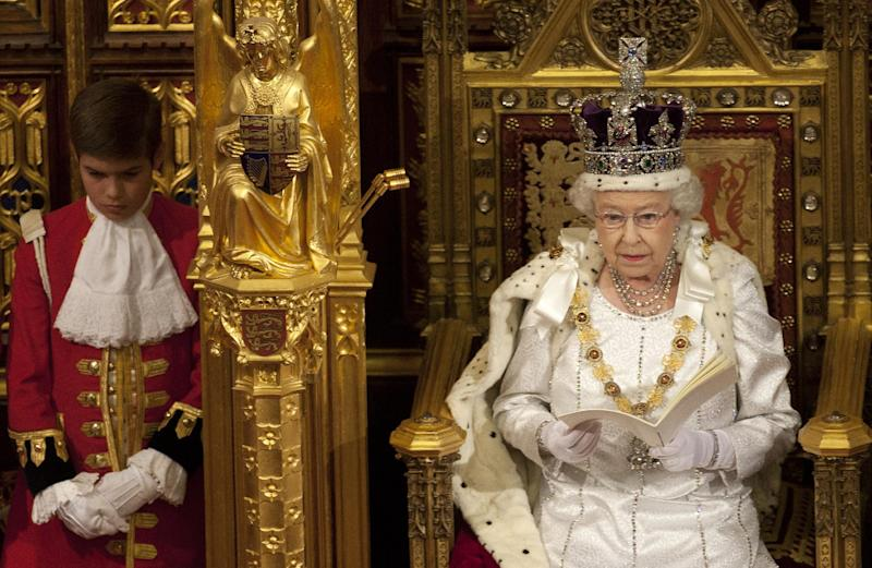 CORRECTS DATE TO 2012  Britain's Queen Elizabeth II reads the Queen's Speech to lawmakers in the House of Lords in London, Wednesday, May 9, 2012. Queen Elizabeth II said Wednesday that Britain's government plans to finally reform the centuries-old House of Lords and introduce direct elections for members. Announcing the government's new legislative program in an opulent pageant of pomp and politics, the queen said planned laws would introduce a smaller, mainly upper elected chamber. (AP Photo/Alastair Grant, Pool)