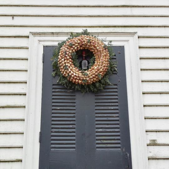 <p>How many holiday toasts had to be made to supply the corks for this decadent wreath? <i>(Photo: Christian Carollo/Say Hello to America)</i></p>