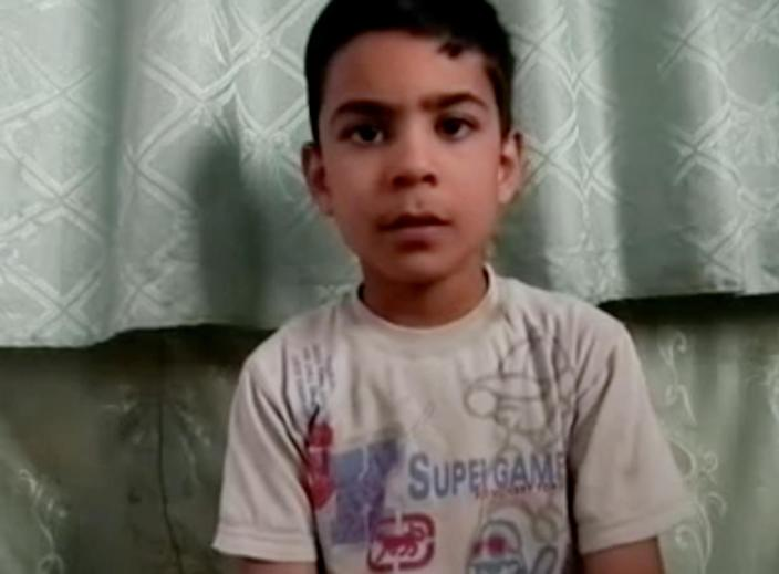 This image made from amateur video, released by the Houla Media Office and accessed Thursday, May 31, 2012 purports to show 11-year-old Ali el-Sayed, a survivor of the Houla massacre that began Friday and left 108 people dead, many of them children and women. Ali is one of the few survivors of the weekend massacre in Houla, a collection of poor farming villages and olive groves in Syria's central Homs province. More than 100 people were killed, many of them women and children who were shot or stabbed in their houses. (AP Photo/Shaam News Network via AP video) THE ASSOCIATED PRESS CANNOT INDEPENDENTLY VERIFY THE CONTENT, DATE, LOCATION OR AUTHENTICITY OF THIS MATERIAL