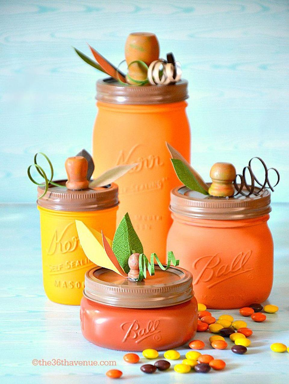 """<p>These pretty painted containers can work as a <a href=""""https://www.countryliving.com/diy-crafts/g2009/fall-centerpieces/"""" rel=""""nofollow noopener"""" target=""""_blank"""" data-ylk=""""slk:centerpiece"""" class=""""link rapid-noclick-resp"""">centerpiece</a>, as candy jars, or both!</p><p><strong>Get the tutorial at <a href=""""http://www.the36thavenue.com/diy-pumpkin-mason-jars/"""" rel=""""nofollow noopener"""" target=""""_blank"""" data-ylk=""""slk:The 36th Avenue"""" class=""""link rapid-noclick-resp"""">The 36th Avenue</a>.</strong></p>"""