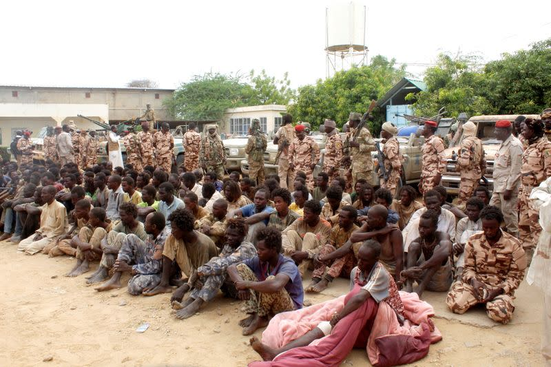 Captured FACT rebels are pictured at army headquarters in N'Djamena