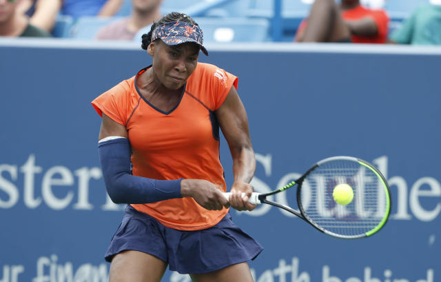Venus Williams returns a backhand against Lauren Davis during first round play at the Western & Southern Open tennis tournament, Monday, Aug. 12, 2019, in Mason, Ohio. (AP Photo/Gary Landers)