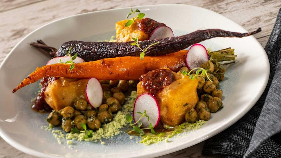 <p>Who knew that the menu at the highly coveted Cinderella's Royal Table in Magic Kingdom had such range. The Chickpea Panisse has chermoula-spiced legumes and tomato jam with chive powder. It's a meal fit for a princess.</p>