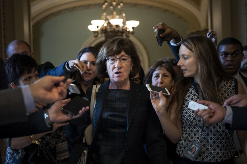 Susan Collins, center