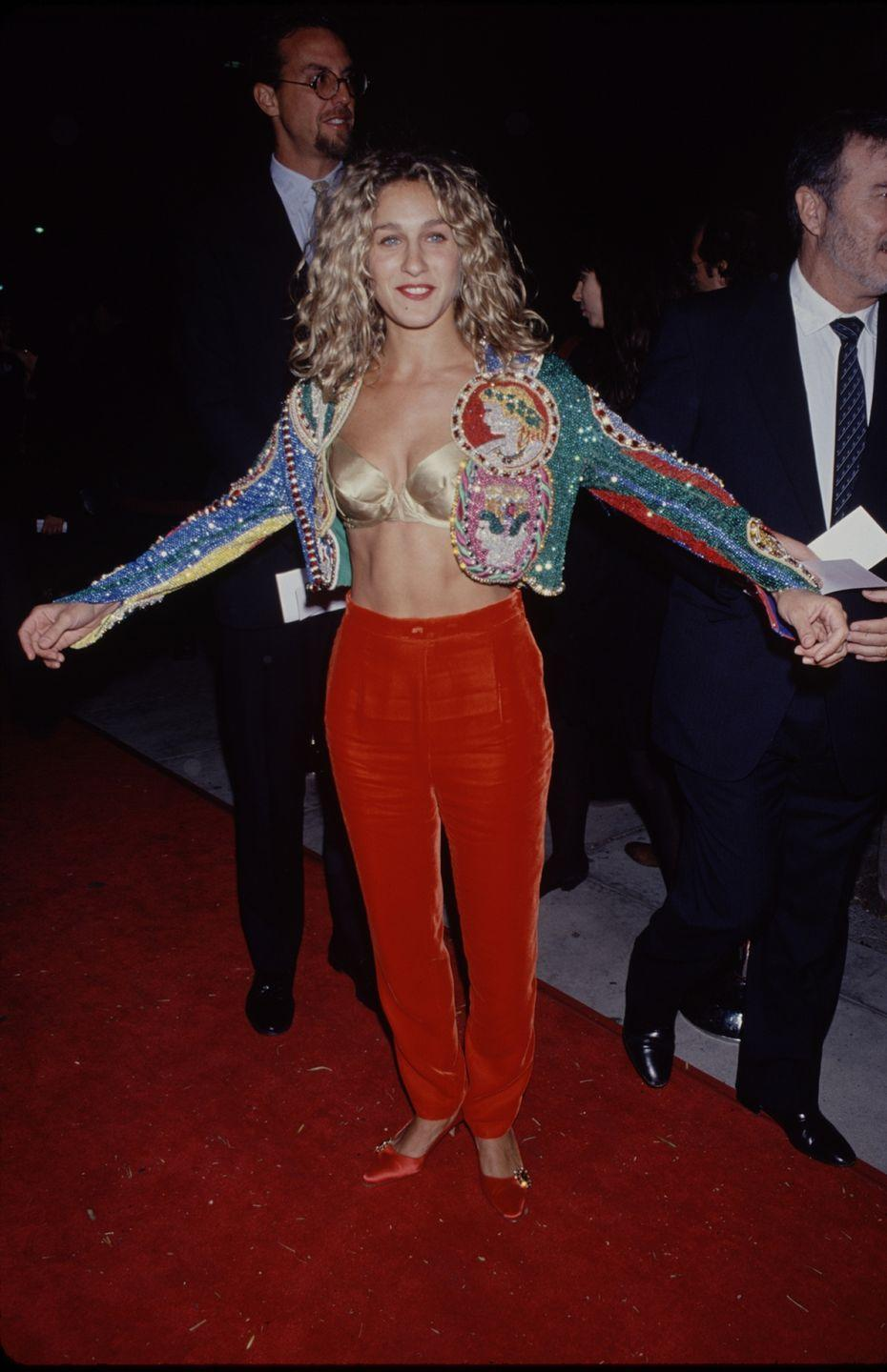 <p>Yes, Carrie Bradshaw wears some truly OTT looks in <em>Sex and the City</em>, but none rival this one that SJP wore in '95. The metallic bra? The beaded jacket? The satin pumps? There is so much happening here that I am truly overwhelmed. </p>