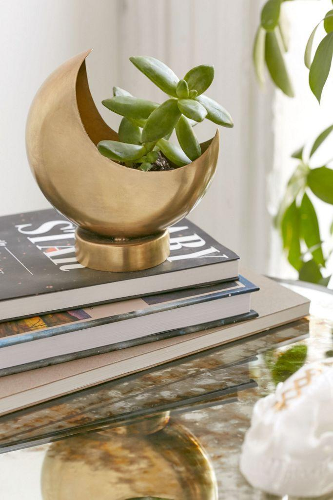 "<h3>Half Moon 4"" Planter<br></h3><br>""This planter will inspire your fiesty BFF to change up their home decor and embrace some worldly, eco-friendly sentiments,"" says Stardust. <br><br><br><strong>Urban Outfitters</strong> Half Moon 4"" Planter, $, available at <a href=""https://go.skimresources.com/?id=30283X879131&url=https%3A%2F%2Fwww.urbanoutfitters.com%2Fshop%2Fhalf-moon-4-planter"" rel=""nofollow noopener"" target=""_blank"" data-ylk=""slk:Urban Outfitters"" class=""link rapid-noclick-resp"">Urban Outfitters</a>"