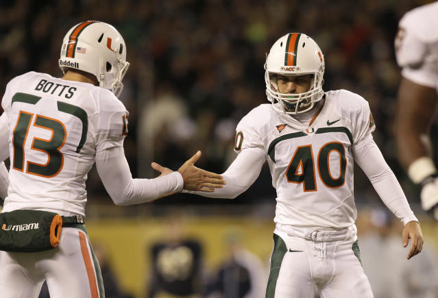 Miami kicker Jake Wieclaw (40) celebrates with holder Dalton Botts after Wieclaw's field goal during the first half of an NCAA college football game against Notre Dame at Soldier Field Saturday, Oct. 6, 2012, in Chicago. (AP Photo/Nam Y. Huh)
