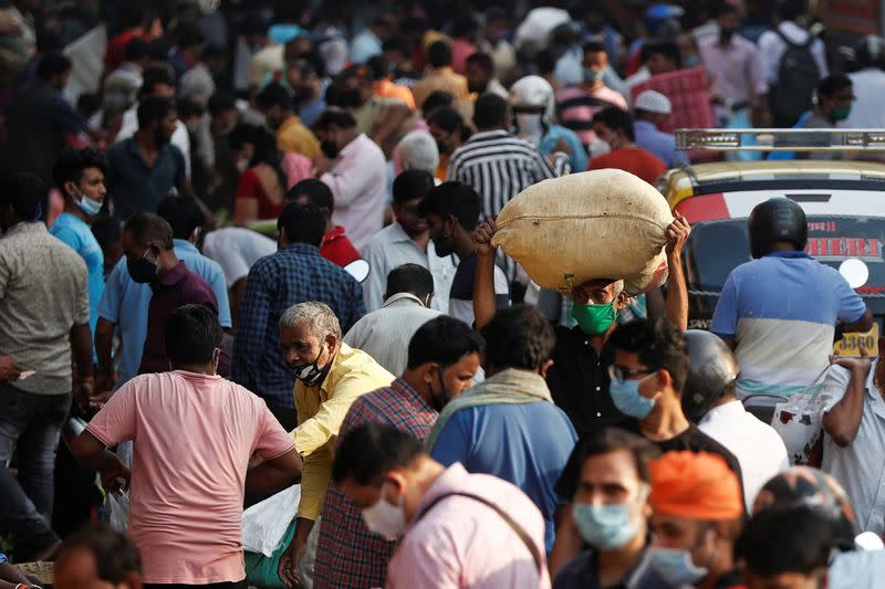 People are seen at a crowded market in Mumbai