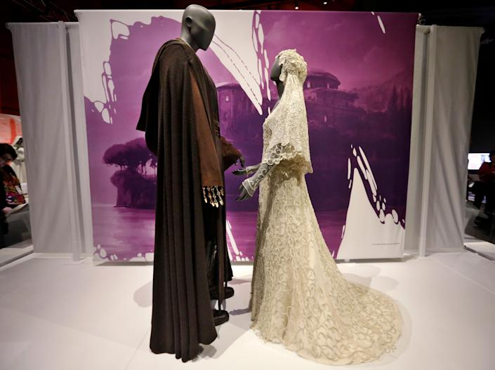 Anakin Skywalker's Jedi robe and the wedding gown of his bride, Padme Amidala. (AP Photo/Elaine Thompson)