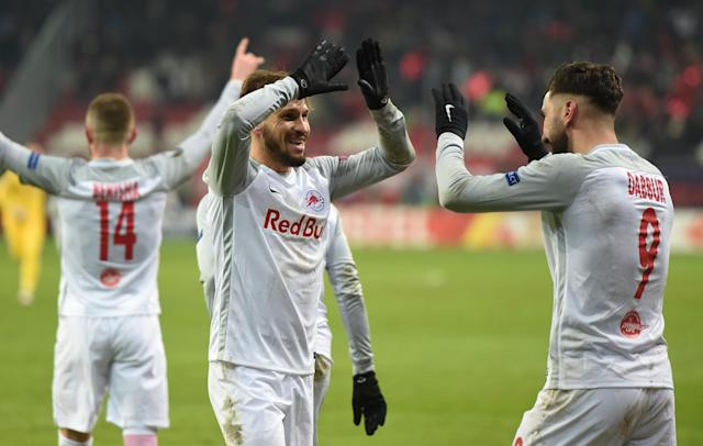 Soccer Football - Europa League Round of 32 Second Leg - RB Salzburg vs Real Sociedad - Red Bull Arena Salzburg, Salzburg, Austria - February 22, 2018 RB Salzburg's Moanes Dabour and Andreas Ulmer celebrate at the end of the match REUTERS/Andreas Gebert