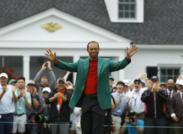 Tiger Woods smiles as he wears his green jacket after winning the Masters golf tournament Sunday, April 14, 2019, in Augusta, Ga. (AP Photo/Matt Slocum)