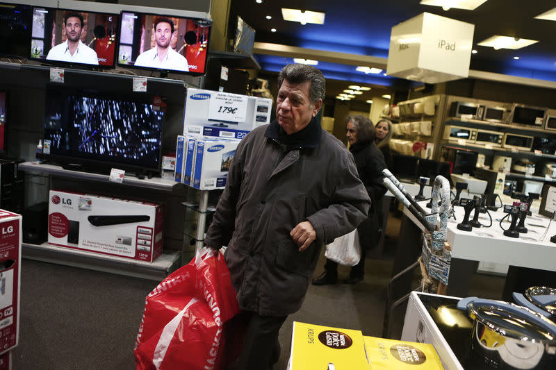 A customer leaves an Electroniki shop in Athens