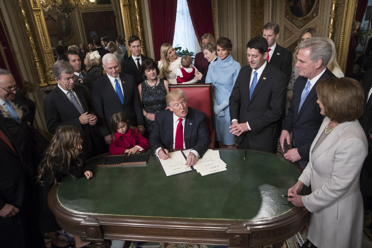 <p>President Donald Trump is joined by the Congressional leadership and his family as he formally signs his cabinet nominations into law, in the President's Room of the Senate, at the Capitol in Washington,January 20, 2017. From left are Senate Minority Leader Chuck Schumer, D-N.Y., Sen. Roy Blunt, R-Mo., Donald Trump Jr., Vice President Mike Pence, Jared Kushner, Karen Pence, Ivanka Trump, Barron Trump, Melania Trump, Speaker of the House Paul Ryan, R-Wis., Majority Leader Kevin McCarthy, D-Calif., House Minority Leader Nancy Pelosi, D-Calif. (Photo: J. Scott Applewhite, Pool/AP) </p>