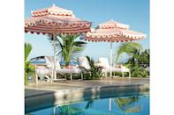 """<p><b>Speightstown, Barbados</b></p> <p>Revered for its strand of hotels and resorts that cater to (and hide away) a platinum roster of expats and visitors from royals to rock stars, the west coast of Barbados remains one of the Caribbean's most exclusive addresses. What a joy to witness the superb refreshing over five years of one of the area's most beloved small hotels, the ever-chic <a href=""""https://www.cobblerscove.com/"""" rel=""""nofollow noopener"""" target=""""_blank"""" data-ylk=""""slk:Cobblers Cove"""" class=""""link rapid-noclick-resp"""">Cobblers Cove</a>. With British design studio <a href=""""https://www.soane.co.uk/"""" rel=""""nofollow noopener"""" target=""""_blank"""" data-ylk=""""slk:Soane Britain"""" class=""""link rapid-noclick-resp"""">Soane Britain</a> transforming the great entrance hall, drawing room, and two signature suites, the new look is a pitch-perfect marriage of whitewashed rattan and hand-painted linens in pale pinks, blues, and greens. Forty suites occupy 10 cottages amid lush landscaping, while those signature suites overlook it all from the Great House. An elegant pool, blush-striped umbrellas, and the turquoise Caribbean are the perfect counterpoint. Rates start at $400; <a href=""""https://www.cobblerscove.com/"""" rel=""""nofollow noopener"""" target=""""_blank"""" data-ylk=""""slk:cobblerscove.com"""" class=""""link rapid-noclick-resp"""">cobblerscove.com</a>.</p>"""
