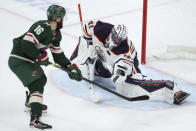 Edmonton Oilers goalie Mike Smith (41) protects the net against a shot by Minnesota Wild's Jason Zucker (16) during the second period of an NHL hockey game Tuesday, Oct. 22, 2019, in St. Paul, Minn. (AP Photo/Stacy Bengs)