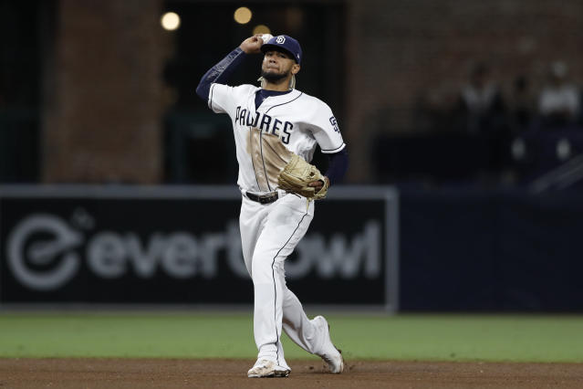 San Diego Padres shortstop Fernando Tatis Jr. throws to first for the out on Tampa Bay Rays' Guillermo Heredia during the fifth inning of a baseball game Monday, Aug. 12, 2019, in San Diego. (AP Photo/Gregory Bull)