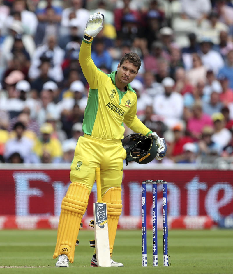 Helmet knocked off, bloodied Carey bats on for Australia