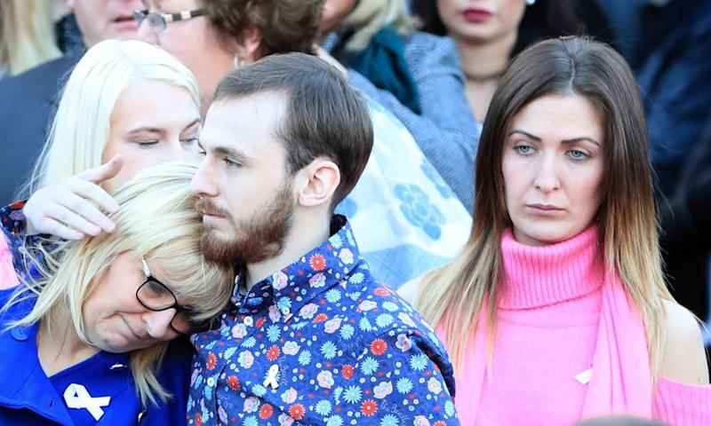 Jack Sargeant comforts his mother Bernie at this father's funeral