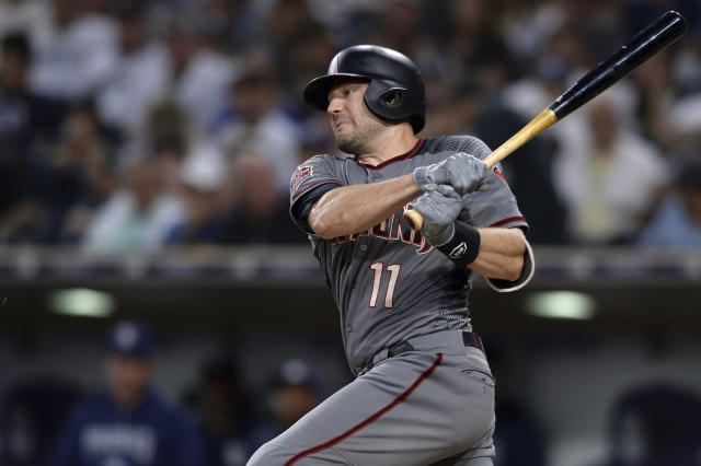 FILE - In this Aug. 16, 2018, file photo, Arizona Diamondbacks' A.J. Pollock bats during the first inning of a baseball game against the San Diego Padres, in San Diego. The Los Angeles Dodgers dumped salary by trading Matt Kemp and Yaisel Puig to Cincinnati while also reducing the outfield glut. Those moves created payroll flexibility to bring in A.J. Pollock from Arizona as the everyday centerfielder. (AP Photo/Orlando Ramirez, File)