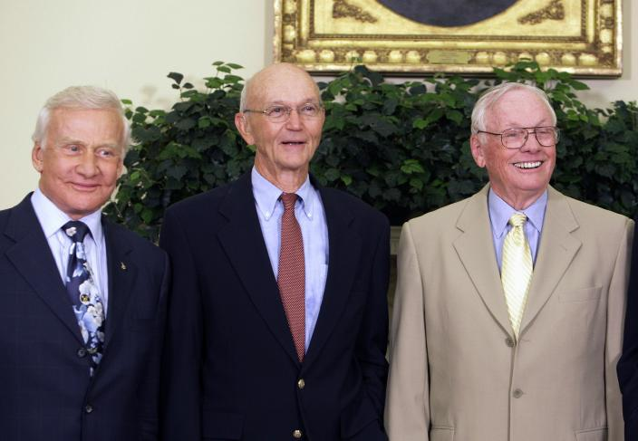 """In this July 20, 2009, photo, Buzz Aldrin, left, Michael Collins, center, and Neil Armstrong stand in the Oval Office at the White House in Washington, on the 40th anniversary of the Apollo 11 moon landing. Neil Armstrong was a quiet self-described nerdy engineer who became a global hero when as a steely-nerved pilot he made """"one giant leap for mankind"""" with a small step on to the moon. The modest man who had people on Earth entranced and awed from almost a quarter million miles away has died, according to his family, on Saturday, Aug. 25, 2012. He was 82. (AP Photo/Alex Brandon)"""