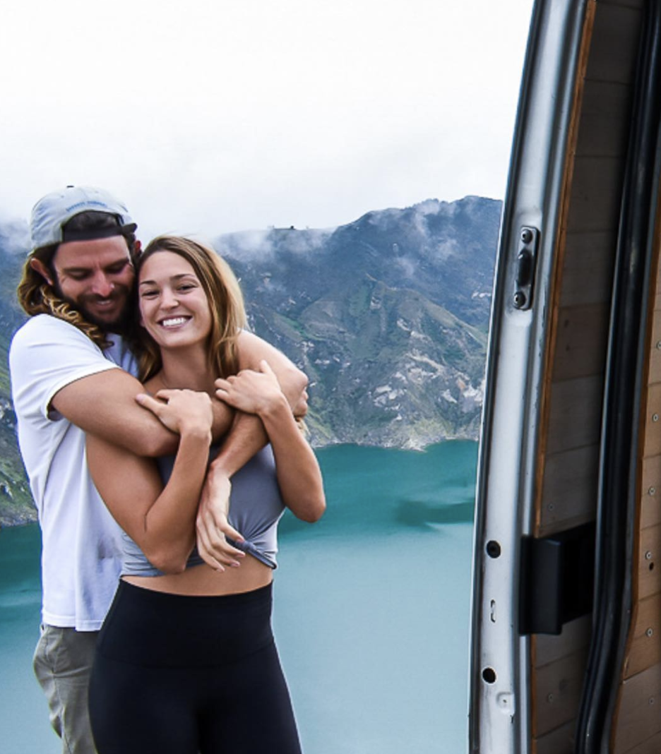 Max Bidstrup with his arms around Lee Macmillian as they pose in front of some mountains.