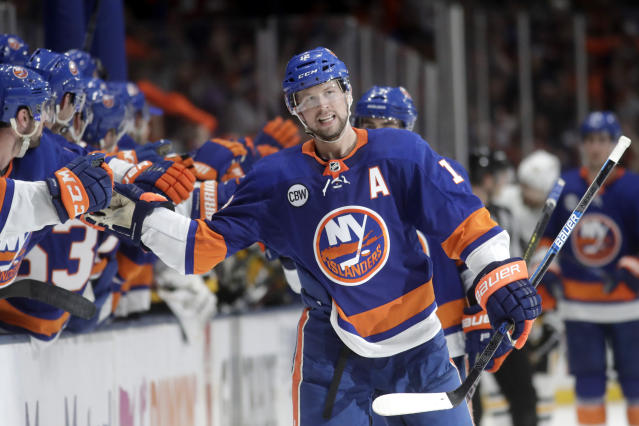 New York Islanders right wing Josh Bailey skates by the bench after scoring a goal on the Pittsburgh Penguins during the third period of Game 2 of an NHL hockey first-round playoff series Friday, April 12, 2019, in Uniondale, N.Y. The Islanders won 3-1. (AP Photo/Julio Cortez)