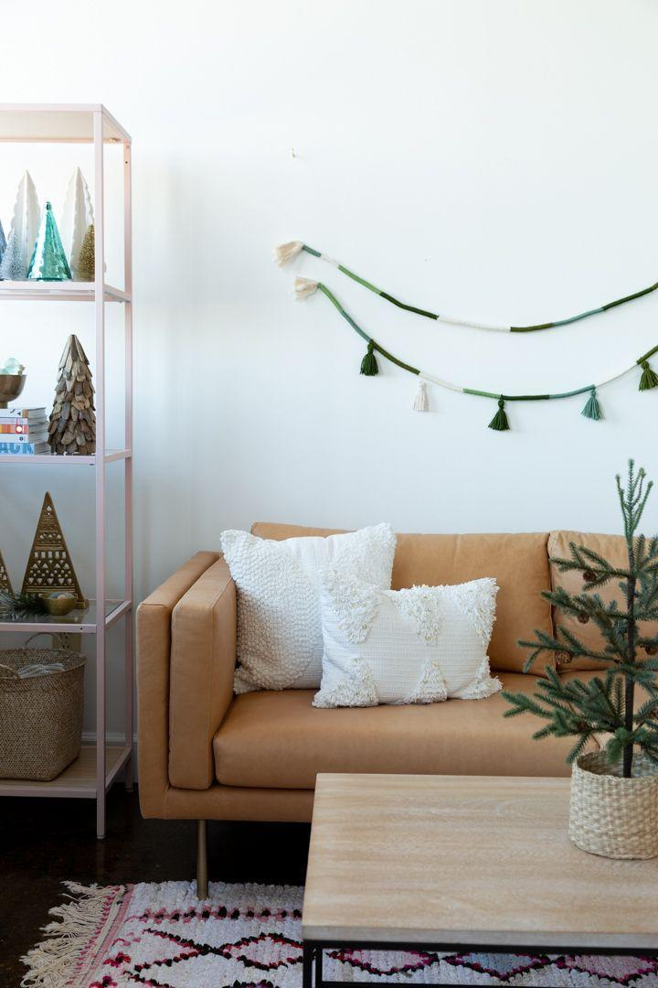 """<p>This boho-inspired holiday garland comes together with three simple supplies: cotton cording, yarn, and glue. And although the green and white color scheme is great for Christmas, it's highly customizable. </p><p><a href=""""https://www.aliceandlois.com/diy-wrapped-rope-tassel-garland/"""" rel=""""nofollow noopener"""" target=""""_blank"""" data-ylk=""""slk:Get the tutorial."""" class=""""link rapid-noclick-resp"""">Get the tutorial.</a></p><p><a class=""""link rapid-noclick-resp"""" href=""""https://www.amazon.com/Macrame-Cotton-Colored-Crafts-Hangers/dp/B08Q86NMFW?tag=syn-yahoo-20&ascsubtag=%5Bartid%7C10072.g.37499128%5Bsrc%7Cyahoo-us"""" rel=""""nofollow noopener"""" target=""""_blank"""" data-ylk=""""slk:SHOP CORDING"""">SHOP CORDING</a></p>"""