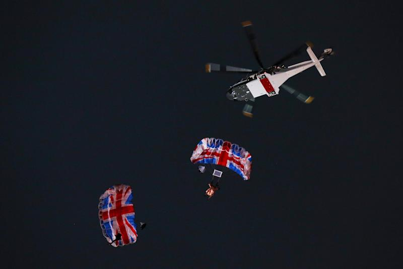 LONDON, ENGLAND - JULY 27: Gary Connery and Mark Sutton parachute into the stadium as part of short James Bond film featuring Daniel Craig and The Queen during the Opening Ceremony of the London 2012 Olympic Games at the Olympic Stadium on July 27, 2012 in London, England. (Photo by Cameron Spencer/Getty Images)