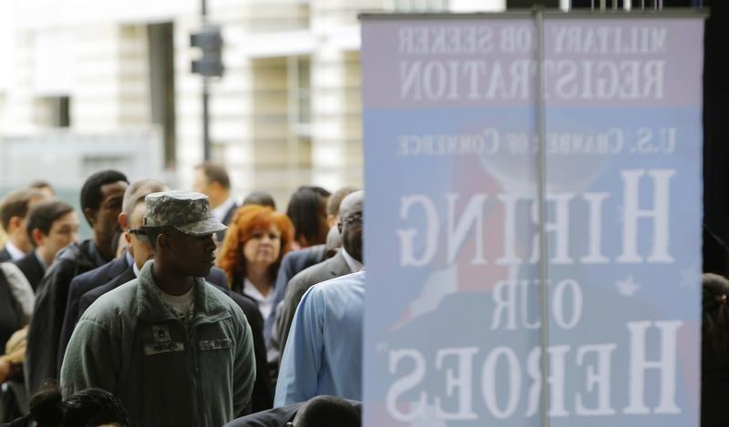 Job seekers line up outside a job fair held by the U.S. Chamber of Commerce and the Washington Nationals baseball club in Washington