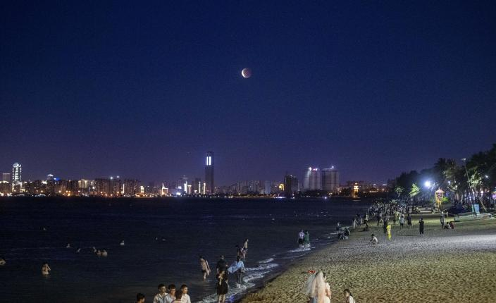 A total lunar eclipse occurred in Haikou's night sky.  capital city of hainan province  Southwest China on May 26, 2021 / credit: Costfoto/Barcroft Media via Getty Images.