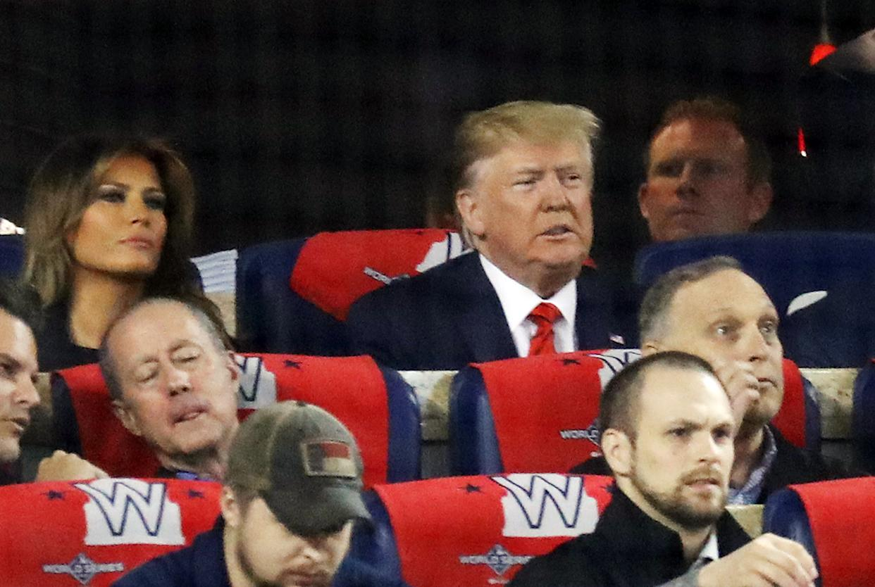 Melania and Donald Trump attend Game Five of the 2019 World Series between the Houston Astros and the Washington Nationals at Nationals Park. (Photo by Rob Carr/Getty Images)