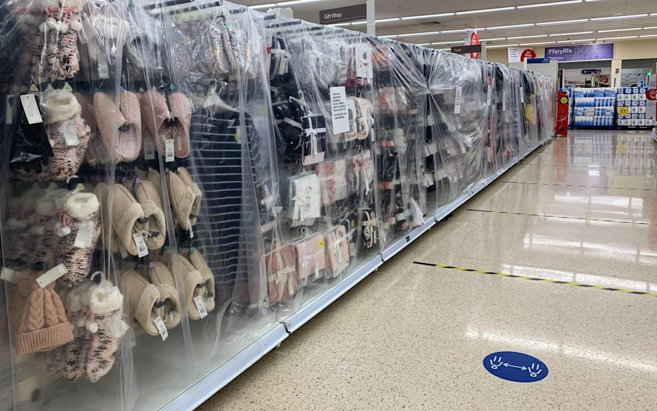 Non-essential items such as clothing are covered up in a Tesco store in Cardiff on Saturday - Polly Thomas/Getty Images
