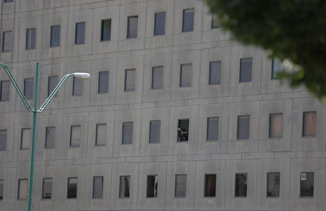 <p>An Iranian policeman looks out of the parliament's building in central Tehran, Iran, June 7, 2017. (Photo: TIMA via Reuters) </p>