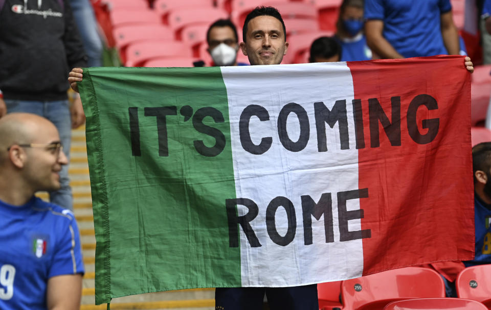 Fan holds up a banner prior the start of the Euro 2020 soccer championship final match between England and Italy at Wembley Stadium in London, Sunday, July 11, 2021. (Paul Ellis/Pool via AP)