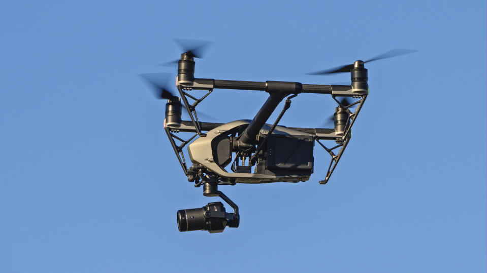 LISBON, PORTUGAL - DECEMBER 03: A drone with a video camera flies over Santo Amaro Recreation dock during Swedish teen climate activist Greta Thunberg arrival on December 03, 2019 in Lisbon, Portugal. The increased use of drones has occasioned a rise in incidents near Lisbon, where one of them crashed on the runway, and other airports. In 2018, the National Civil Aviation Authority (ANAC) reported 53 drone incidents, near almost as many as the 59 reported between 2015 and 2017. (Photo by Horacio Villalobos - Corbis/Corbis via Getty Images)