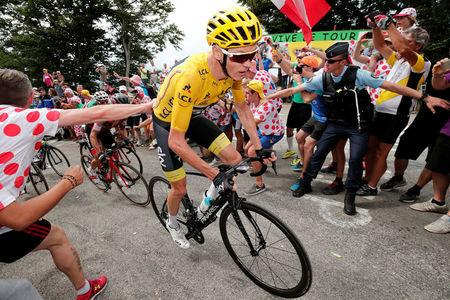 Team Sky rider and yellow jersey Chris Froome of Britain in action in Stage 9. REUTERS/Benoit Tessier