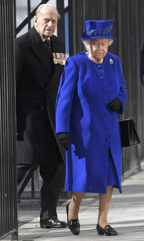 <p>The Queen attended the unveiling of a new Iraq and Afghanistan memorial wearing a royal blue look.<br /><i>[Photo: PA]</i> </p>