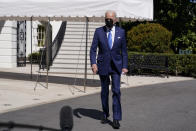 President Joe Biden walks to talk to members of the media before boarding Marine One on the South Lawn of the White House, Friday, March 26, 2021, in Washington. (AP Photo/Evan Vucci)