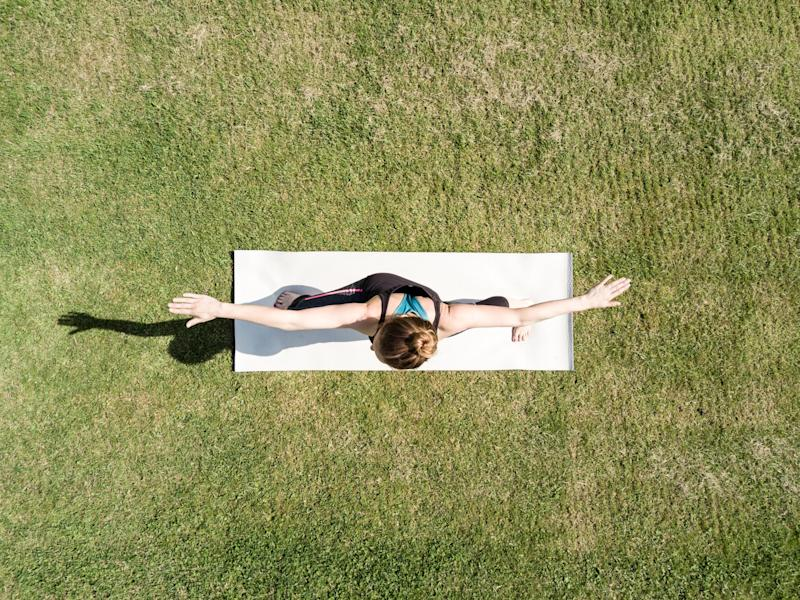 Young woman performing yoga in a park