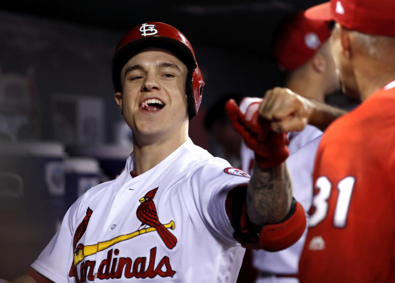 St. Louis Cardinals' Tyler O'Neill is congratulated by teammates in the dugout after hitting a three-run home run during the eighth inning of a baseball game against the Pittsburgh Pirates, Tuesday, Sept. 11, 2018, in St. Louis. (AP Photo/Jeff Roberson)