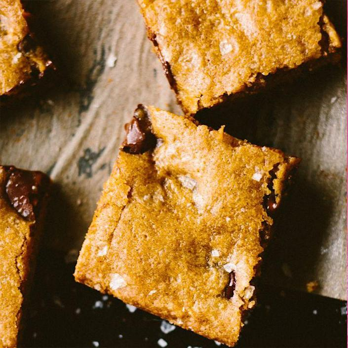 "<p>The added salt to these chocolate chip cookie bars gives us the perfect balance of salty and sweet.<br></p><p><em><a href=""https://www.womansday.com/food-recipes/a27079353/salted-chocolate-chip-cookie-bars-recipe/"" rel=""nofollow noopener"" target=""_blank"" data-ylk=""slk:Get the recipe for Salted Chocolate Chip Cookie Bars."" class=""link rapid-noclick-resp"">Get the recipe for Salted Chocolate Chip Cookie Bars.</a></em></p>"